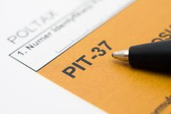 Filling in polish tax form Stock Photos