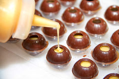 Filling pralines Stock Photos