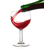 Filling red wine on white background Stock Photography