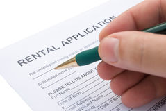 Filling a rental agreement. Application Royalty Free Stock Images