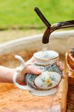 Filling a spa cup Stock Photography