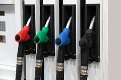 Filling station. Fuelling nozzles on gasoline filling station Stock Images