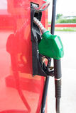 Filling station. Green  pump fuel Royalty Free Stock Images
