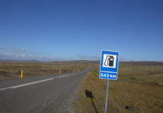 Filling stations are rare thing in Iceland. Icelandic landscape with outwash plain, hills and road sign informing about a petrol station Stock Photo