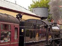 Filling a steam engine with coal. In preperation for its next journey at the East Lancs Railway 40's weekend. Lancashire, UK stock photos
