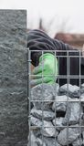 Filling the stone wall with gravel Royalty Free Stock Photography