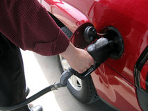 Filling The Tank. A Man's Hand Pumping Gas Stock Photo