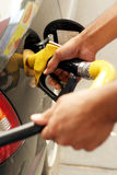 Filling the tank. Filling a tank with gasoline, or petrol Stock Photo