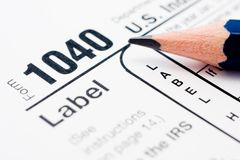 Filling in tax form 1040 Royalty Free Stock Images