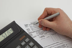 Filling tax form Stock Image