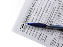 Filling in tax form 1040 Stock Photos