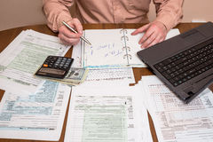 Filling 1040 tax form Stock Images