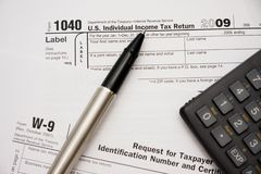 Filling tax forms 1040 Royalty Free Stock Photo