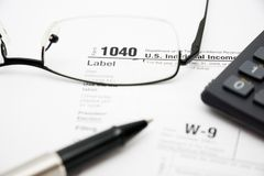 Filling tax forms 1040 Stock Photos