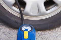 Filling tires with air Royalty Free Stock Photography