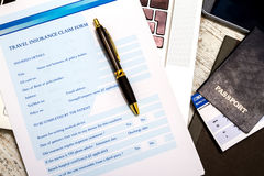 Filling a Travel insurance claim form Stock Photo