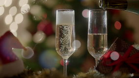 Filling two glasses with champagne on New Years party stock video footage