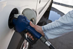 Filling up. A man's hand holding a gas pump nozzle Royalty Free Stock Photos