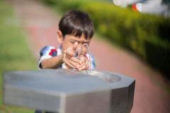 Filling up bottle from public water fountain Royalty Free Stock Photography