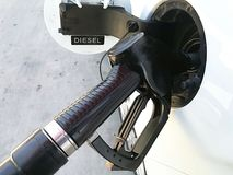Filling up a car with diesel fuel. Filling up a car tank at the gas station with diesel fuel. Petroleum, benzine, gas oil, pump, gas, station, energy royalty free stock photos