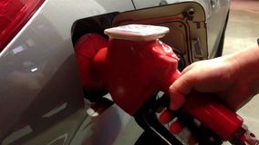 Filling up car gas tank with fuel at gas  station. Filling up car gas tank with fuel at gas station. Closeup on hand and pump stock video