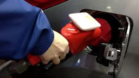 Filling up car gas tank with fuel at station. Stock Photos
