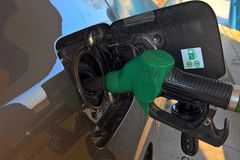 Filling up the car gas tank. With standard petrol gasoline royalty free stock image