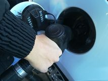 Fill up the tank. Filling up the diesel tank in the car at the gas station. Benzine, fuel, petrol Royalty Free Stock Photo
