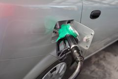 Power and energy fuel filling up. Filling up of  fuel at petrol station, closeup of equipment Royalty Free Stock Photos