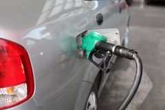 Power and energy fuel filling up. Filling up of  fuel at petrol station, closeup of equipment Royalty Free Stock Images