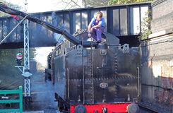 Filling up steam train or locomotive with water. Royalty Free Stock Photos