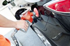 Filling up the tank. A man pumping up the gas at the gas station royalty free stock photos