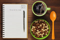 Filling up to do list while having a breakfast. Day planning and filling up to do list while having healthy breakfast in the spring morning royalty free stock image