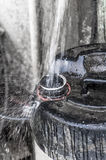 Filling up water in cans Stock Photos