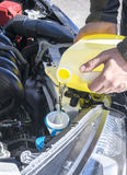 Filling Up Windshield Washer Fluid in a Car Royalty Free Stock Photography