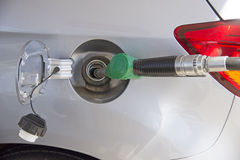 Filling vehicle fuel tank with petrol Stock Photo