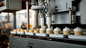 Filling of wafer cups with ice cream. Ice cream production line. Vanilla ice cream. Ice cream production line. Filling of wafer cups with ice cream. Ice cream stock footage