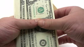 Filling Wage Packet. Man putting Dollar banknotes into a brown envelope. Canon HV30. HD 16:9 1920 x 1080 at 25.00 fps. Progressive scan. Photo JPG Compression stock footage