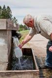 Filling Water Jugs Royalty Free Stock Image