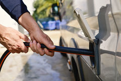Filling the water tank of a campervan Royalty Free Stock Image