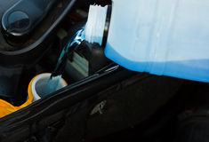 Filling the windshield washer resevoir Royalty Free Stock Photography