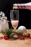Filling wine glass pink sparkling drink Stock Images