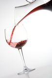 Filling wineglass from decanter Stock Photo