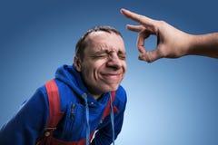 Fillip on forehead Stock Photo