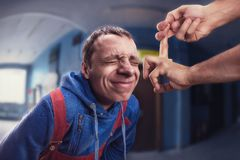 Fillip on man's forehead Royalty Free Stock Images