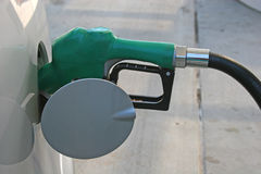 Fillup. Gas nozzle in tank of SUV Royalty Free Stock Photos