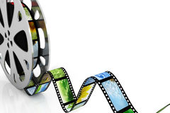 Film. Reel with images over white Stock Photo