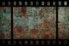 Film. Photographic film with rusty background royalty free stock photography