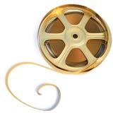 Film. Golden film reel. isolated on white Stock Photography