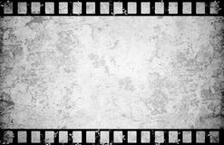 Film. Old paper with film strip background Royalty Free Stock Photo